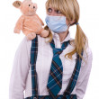 Pig flu virus.Schoolgirl with mask is af — Stock Photo