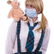 Pig flu virus.Schoolgirl with mask is af — Photo