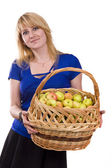 Girl with a basket full of fruits — Stok fotoğraf