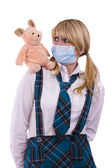 Pig flu virus.Schoolgirl with mask is af — Stockfoto