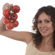 Woman holding branch of tomatoes — Stock Photo
