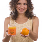 Woman with orange and orange juice. — Stock Photo