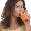 Girl is drinking orange juice. — Stock Photo #1166742
