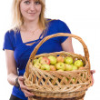 Girl with a basket of apples. — Stock Photo