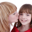 Stock Photo: Mother is kissing her happy daughter.