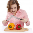 Housewife with sweet peppers and knifes. — Stock Photo