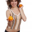Smiling young healthy woman is holding t — Stock Photo