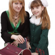 Mother is packing up backpack with daugh — Stockfoto #1168821