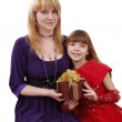 Mother and daughter with gift. — Stock Photo