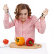Woman wants to eat sweet peppers. — Stockfoto