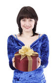 Beautiful woman with a gift. — Stock Photo
