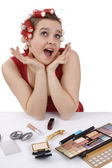 Woman with curlers in her hair looking s — Stock Photo