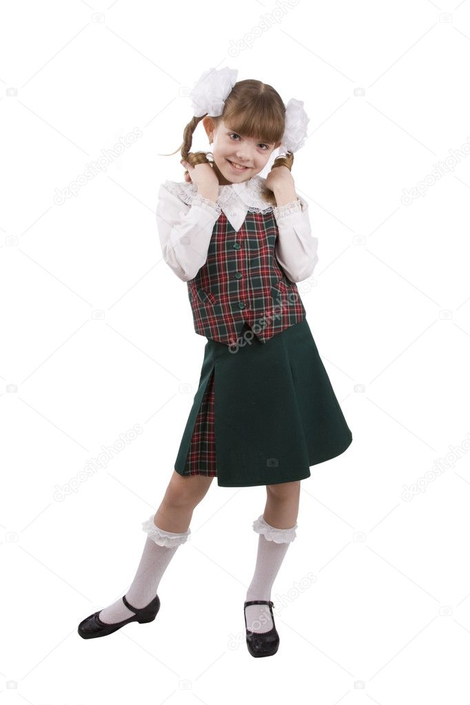 Little girl in school uniform. Pupil is trifling with hair. Isolated on white in studio. — Photo #1166916
