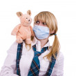Pig flu virus.Schoolgirl with mask — Stockfoto