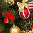 Fragment of Christmas tree decorated - Stock Photo