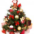 Foto Stock: Christmas tree decorated in red and gold