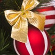 Red ball decorates on Christmas tree — Stok fotoğraf