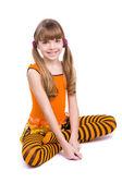 Little girl wearing orange dress — Stock Photo
