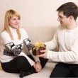 Man giving gifts woman at Valentine — Stockfoto