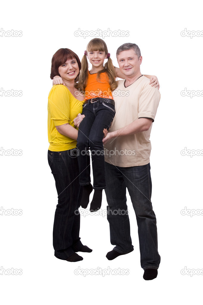 Happy family. Mother and father are holding a little daughter. Woman, man and girl are standing  and smiling  on the floor and posing happily on white backgroun  Stock Photo #1913090