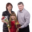 Father giving gift daughter and mother - Stock Photo