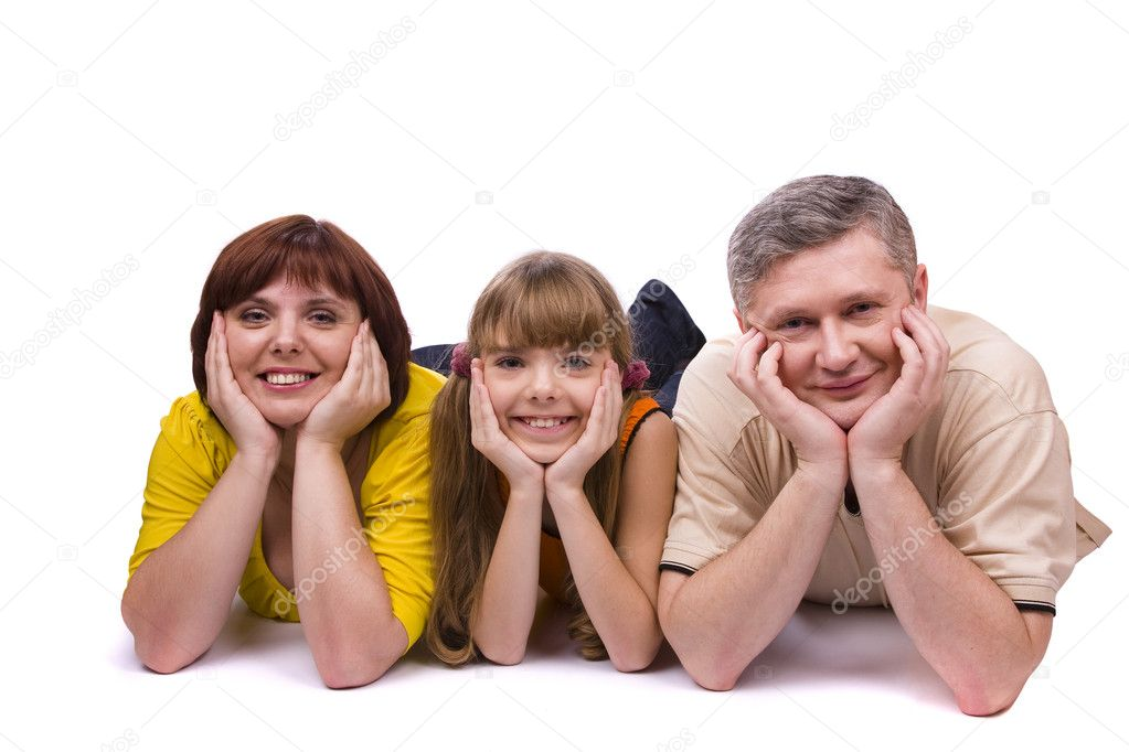 Happy family. Mother, father and little daughter are smiling . Woman, man and girl are lying on the floor and posing happily on white background.  Stock Photo #2170971