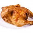 Roasted chicken on plate — Stock Photo