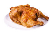 Roasted chicken on plate — Stockfoto