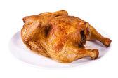 Rostad kyckling på tallrik — Stockfoto