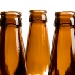 Close-up of two row of beer bottles — Stock Photo