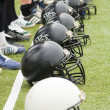 Row of football helmets — Stok fotoğraf