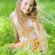 Little girl in perfect green grass — Stock Photo