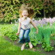 Funny little girl jumping — Stock Photo