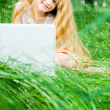 Smiling little girl with laptop — Stock Photo #1249551