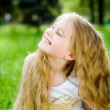 Smiling little girl outside — Stock Photo