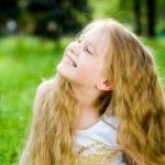 Smiling little girl outside — Stock Photo