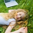Stock Photo: Funny little girl with laptop outside