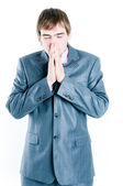 Sad businessman with hands clasped toget — Stock Photo