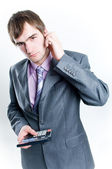 Serious looking businessman with calcula — Stock Photo