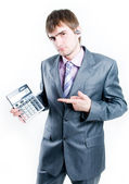 Disappointed businessman with calculator — Stok fotoğraf