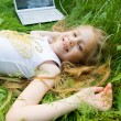 Smiling little girl with laptop outside — Stock Photo #1250000