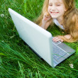 Cute little girl with laptop — Stock Photo #1250037