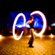 Girl with fire, blurred motion - Stock Photo