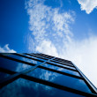 Skyscraper reflecting clouds - Stock Photo