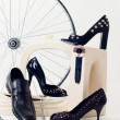 Conceptual still-life with shoes and whe - Stock Photo