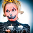 Halloween girl with candles — Stock Photo