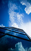 Skyscraper reflecting clouds — Stock Photo