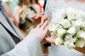 Close-up of newly-married putting on rin — Stock Photo