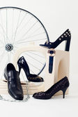 Conceptual still-life with shoes and whe — Stock Photo