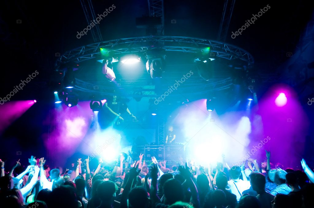Dancing at the concert, laser show and music  Stock Photo #1251797